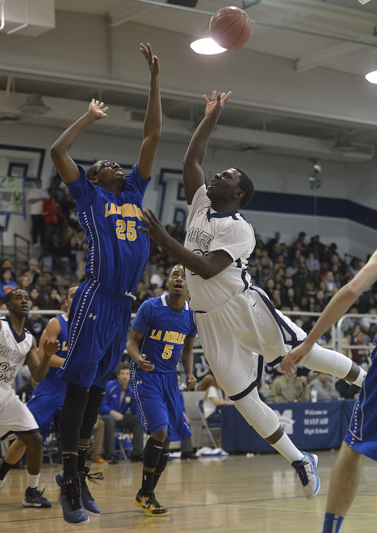 . LAKEWOOD, CALIF. USA -- Mayfair\'s William English (23) goes up for a shot against La Mirada\'s Dezmon Murphy (25) in Lakewood, Calif., on February 8, 2013. Mayfair defeated La Mirada 60 to 59. Photo by Jeff Gritchen / Los Angeles Newspaper Group