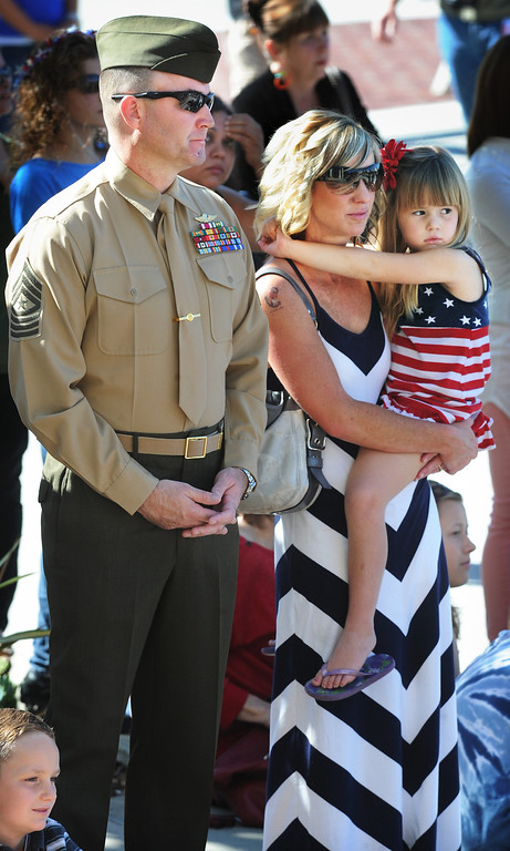 . Sgt. Major Daid Lee, 2nd Battalion 23rd Marine Corp in Pasadena with his family, Talon, and Sierra, held by his wife Sarah Lee attending Pasadena�s annual Veterans Day Ceremony in front of Pasadena City Hall at Centennial Square. Monday, November 11, 2013. The public, veterans, their families, friends and all uniformed military and first-responders, joined together to help honor the men and women of the U.S. Armed Forces. This year�s event, while recognizing the important contributions made by all veterans, will have a special emphasis on honoring the nation�s youngest and newest veterans. The Veterans Day celebration is co-sponsored by the Pasadena Veterans Day Committee and the City of Pasadena.(Photo by Walt Mancini/Pasadena Star-News)