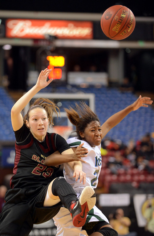 . Alemany\'s Leslie Lopez-Wood becomes entangled with Briannah Smith of Sacred Heart Cathedral during the Div III 2013 CIF State Basketball Championship game at the Sleep Train Arena, in Sacramento, Ca March 22, 2013.  Alemany won the game 46-40.(Andy Holzman/Los Angeles Daily News)