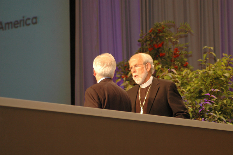 Presiding Bishop Mark S. Hanson confers with Secretary David Swartling prior to officially opening the 2009 Churchwide Assembly.