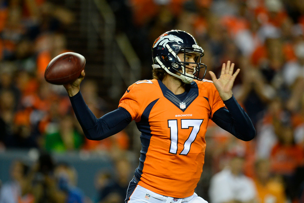. DENVER, CO - AUGUST 23:  Brock Osweiler (17) of the Denver Broncos looks to pass against the Houston Texans during a preseason football game at Sports Authority Field at Mile High on Saturday, August 23, 2014 in Denver, Colorado.  (Photo by Kent Nishimura/The Denver Post)