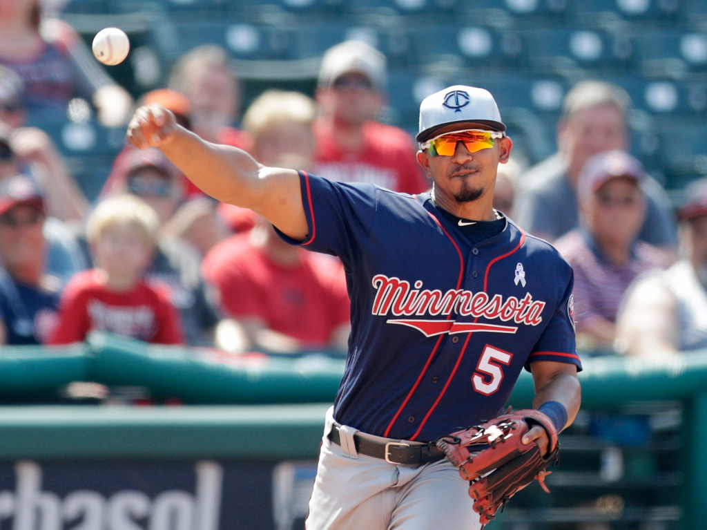 . Minnesota Twins\' Eduardo Escobar throws to first base to try and get Cleveland Indians\' Yan Gomes out in the eighth inning of a baseball game, Sunday, June 17, 2018, in Cleveland. Gomes advanced to second base on throwing error by Escobar. (AP Photo/Tony Dejak)