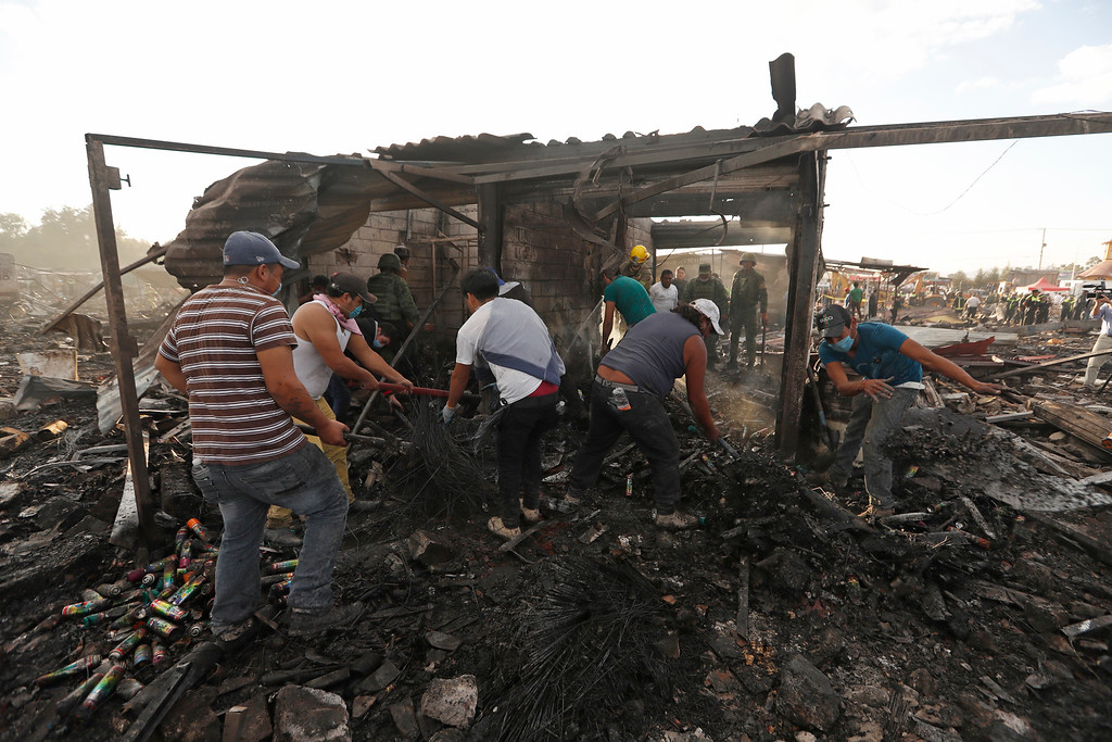 . Local residents comb through ashes and rubble at the scorched ground of Mexico\'s best-known fireworks market after an explosion explosion ripped through it, inTultepec, Mexico, Tuesday, Dec. 20, 2016. National Civil Protection Coordinator Luis Felipe Puente told Milenio TV that dozens were hurt but he had no immediate report of any fatalities at the open-air San Pablito Market in Tultepec, in the State of Mexico. (Eduardo Verdugo/AP Photo)