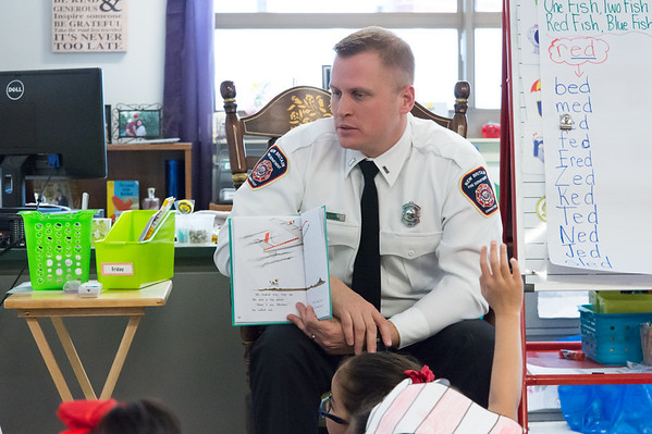 03/01/19 Wesley Bunnell | Staff New Britain Firefighter Lt. Shane Burns reads to kindergarten students at Gaffney Elementary School on Friday March 1st in observance of Read Across America Day and Dr. Seuss's birthday which is annually celebrated on March 2nd.