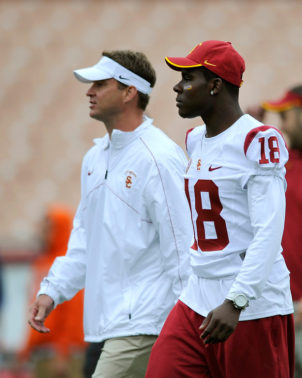 . Head coach Lane Kiffin walks with LB Dion Bailey who didn\'t play at USC\'s Spring Football Game. (Michael Owen Baker/Staff Photographer)