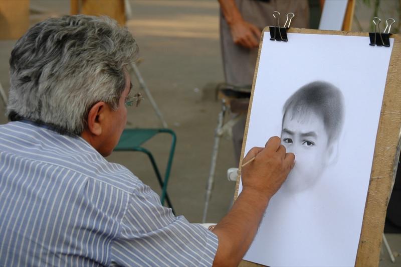 Street Artist Sketching Portraits - Almaty, Kazakhstan