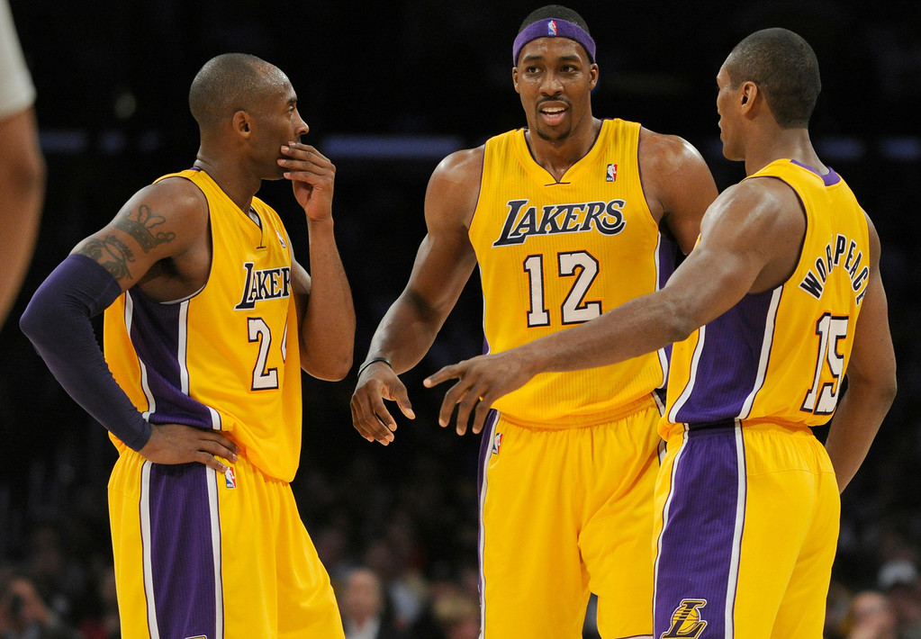 . Lakers Kobe Bryant, Dwight Howard and Metta World Peace have a confab during the 2nd quarter. The Lakers hosted the Brooklyn Nets in a game played at Staples Center in Los Angeles, CA. 11/19/12 (photos by John McCoy/L.A. Daily News)