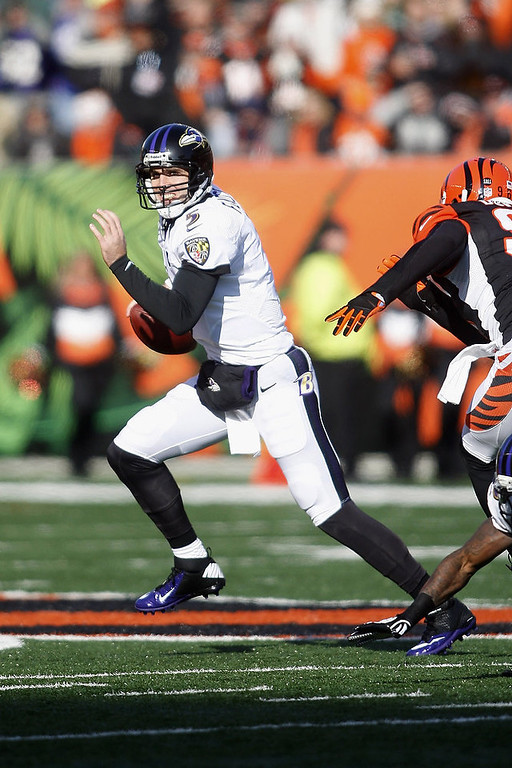 . Joe Flacco #5 of the Baltimore Ravens scrambles out of the pocket during the game against the Cincinnati Bengals at Paul Brown Stadium on December 30, 2012 in Cincinnati, Ohio.  (Photo by John Grieshop/Getty Images)
