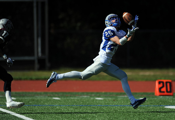 9/29/2018 Mike Orazzi   Staff Bristol Eastern's Jaden Laprise (25) hauls in a TD pass during Saturday's football game with Farmington at FHS.