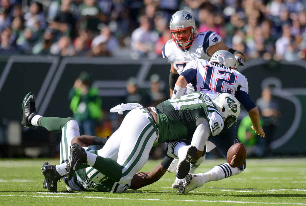 . Free Defensive end Sheldon Richardson #91 of the New York Jets strips the ball from quarterback Tom Brady #12 of the New England Patriots during the 2nd quarter against the New York Jets at MetLife Stadium on October 20, 2013 in East Rutherford, New Jersey. (Photo by Ron Antonelli/Getty Images)