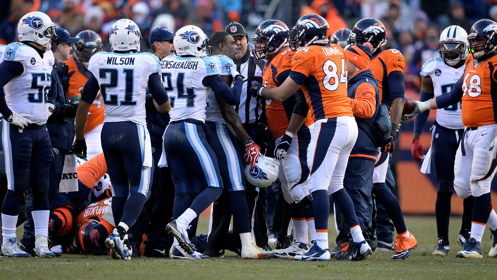. DENVER, CO - DECEMBER 8: Denver Broncos center Manny Ramirez (66) exchanges words with Tennessee Titans strong safety Bernard Pollard (31) while Broncos Wes Welker is still on the ground.  The Denver Broncos vs. the Tennessee Titans at Sports Authority Field at Mile High in Denver on December 8, 2013. (Photo by Hyoung Chang/The Denver Post)