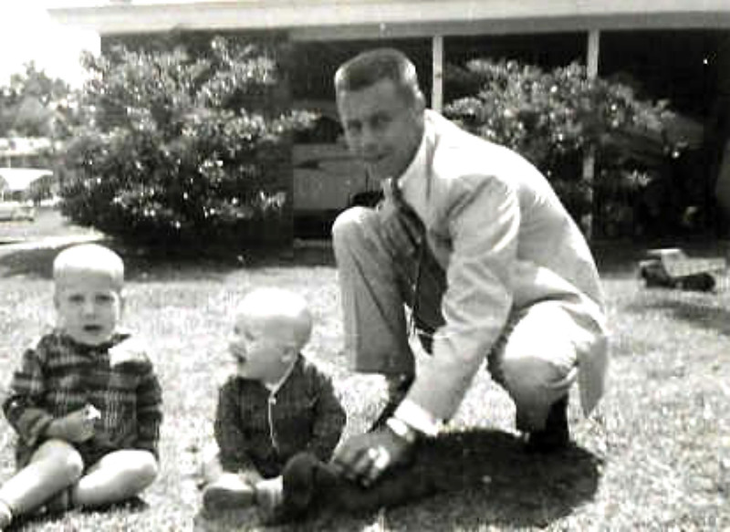 """This picture was taken shortly before my daddy died in a fluke plane crash in France.  Brother Billy on the left was 3 & JB was just a year & 4 days when he died.  & that's Bruno - the world's BEST dog!!!  (amazing how life gives us """"Signs""""!  I was writing this while processing a bunch of stuff that has come up around his death 50 years ago & I JUST realized, in my arms at THIS moment is one of the 8 dogs I'm Dog Sitting - a red-ish dachshund - is buried under my arm pit & looking up at me.  WOW!!!  How OFTEN does that happen - when we don't even """"see"""" the signs of how """"CONNECTED"""" we are that we get!!!???)"""