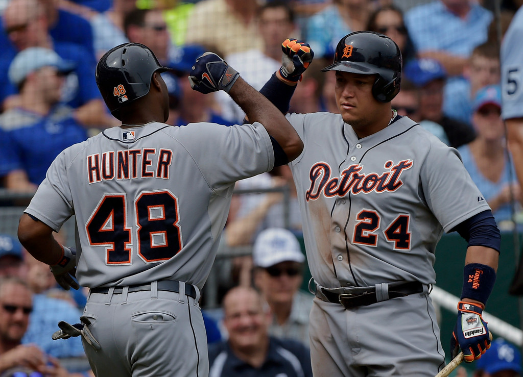 . Detroit Tigers right fielder Torii Hunter (48) celebrates his home run with teammate Detroit Tigers first baseman Miguel Cabrera (24) during the fourth inning of a baseball game against the Kansas City Royals, Saturday, Sept. 20, 2014, in Kansas City, Mo. (AP Photo/Reed Hoffmann)