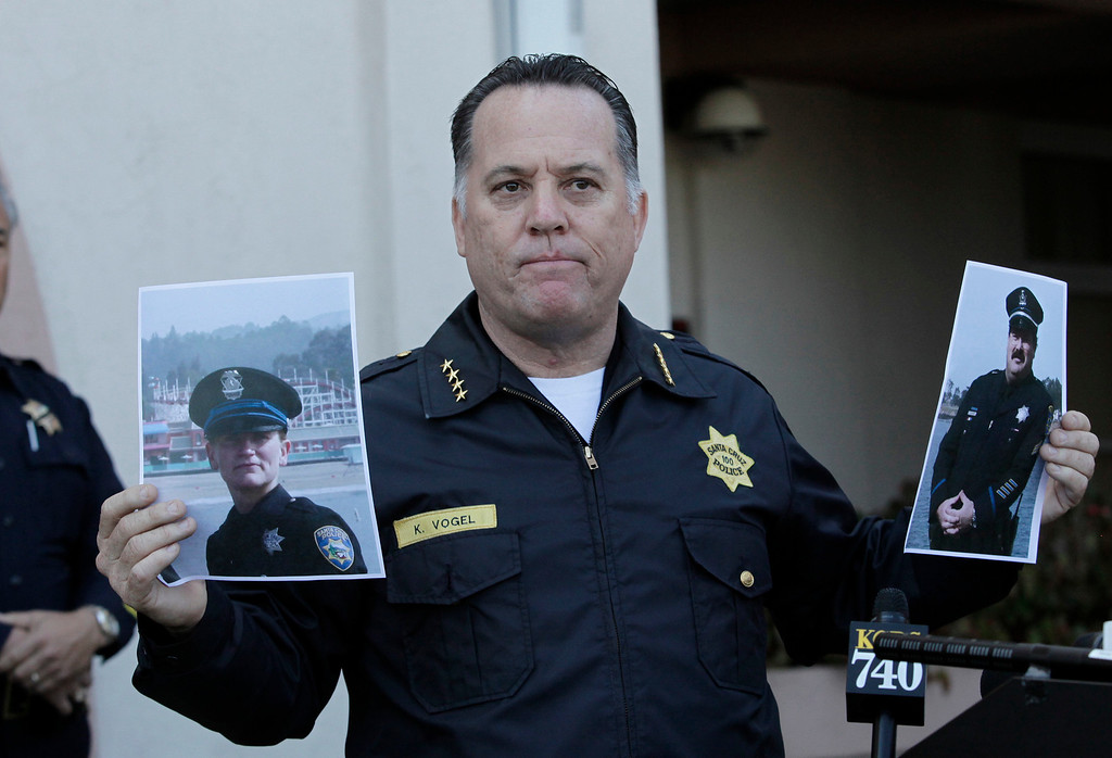 """. Santa Cruz Police Chief, Kevin Vogel holds photo of slain Santa Cruz police officers, detective Elizabeth Butler and detective Sgt. Loran \""""Butch\"""" Baker  during a press conference in front of the police department in Santa Cruz, Calif. on Wednesday, Feb. 27, 2013. The pair were gunned down yesterday while investigating a possible domestic violence or sexual assault when a suspect fired at them. The gunman, Jeremy Peter Goulet, was later gunned down when he exchanged gunfire with police during a manhunt. (Gary Reyes/ Staff)"""