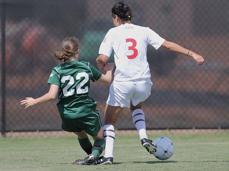 Taylor Napoli (3) fights for possession of the ball.