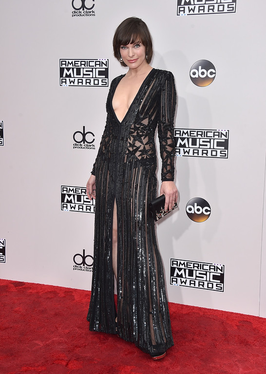 . Milla Jovovich arrives at the American Music Awards at the Microsoft Theater on Sunday, Nov. 20, 2016, in Los Angeles. (Photo by Jordan Strauss/Invision/AP)