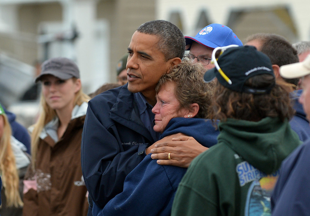 . US President Barack Obama comforts Hurricane Sandy victim Dana Vanzant as he visits a neighborhood in Brigantine, New Jersey, on October 31, 2012. Americans sifted through the wreckage of superstorm Sandy on Wednesday as millions remained without power. The storm carved a trail of devastation across New York City and New Jersey, killing dozens of people in several states, swamping miles of coastline, and throwing the tied-up White House race into disarray just days before the vote.   JEWEL SAMAD/AFP/Getty Images