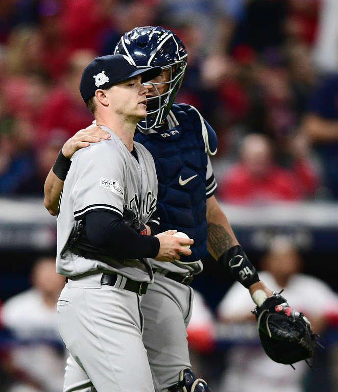 . New York Yankees catcher Gary Sanchez talks with starting pitcher Sonny Gray after Gray hit Cleveland Indians\' Lonnie Chisenhall with a pitch during the second inning of Game 1 of a baseball American League Division Series, Thursday, Oct. 5, 2017, in Cleveland. (AP Photo/David Dermer)