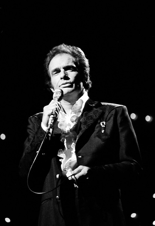 . In this Oct. 8, 1977 file photo, Merle Haggard performs at the Country Music Association Awards in Nashville, Tenn. Haggard died of pneumonia, Wednesday, April 6, 2016, in Palo Cedro, Calif. He was 79.  (AP Photo/Mark Humphrey, File)