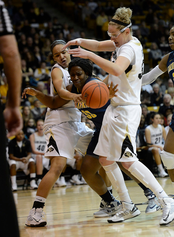 . California Golden Bears center Talia Caldwell (33) loses the ball driving to the basket on Colorado Buffaloes forward Jamee Swan (50) and Colorado Buffaloes forward Jen Reese (34) during the first half Sunday, January 6, 2013 at Coors Events Center. John Leyba, The Denver Post