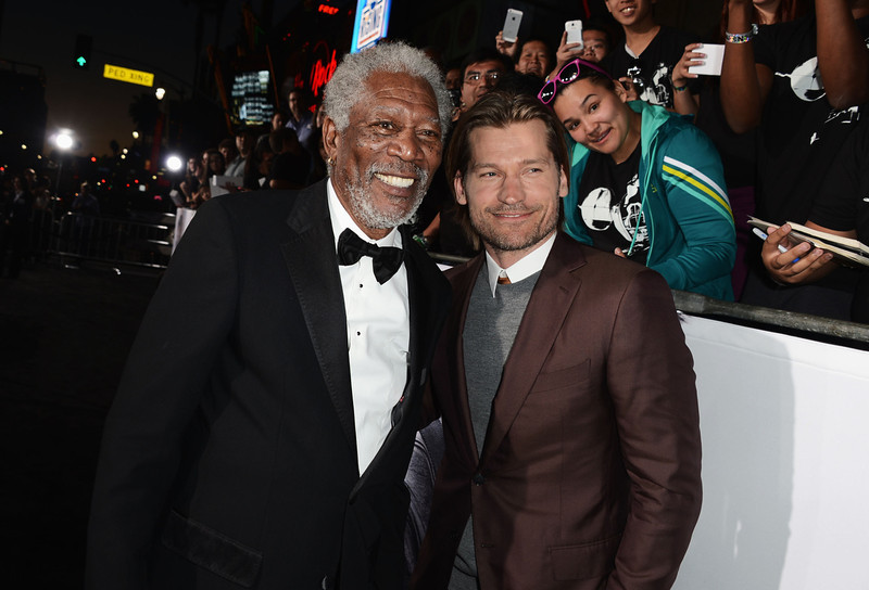 """. Actors Morgan Freeman and Nikolaj Coster-Waldau arrive at the premiere of Universal Pictures\' \""""Oblivion\"""" at Dolby Theatre on April 10, 2013 in Hollywood, California.  (Photo by Kevin Winter/Getty Images)"""