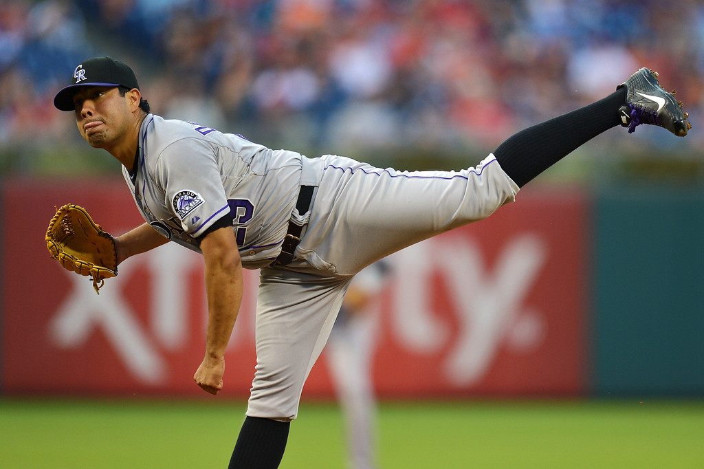 . Jorge De La Rosa #29 of the Colorado Rockies delivers a pitch in the first inning against the Philadelphia Phillies at Citizens Bank Park on August 20, 2013 in Philadelphia, Pennsylvania. (Photo by Drew Hallowell/Getty Images)