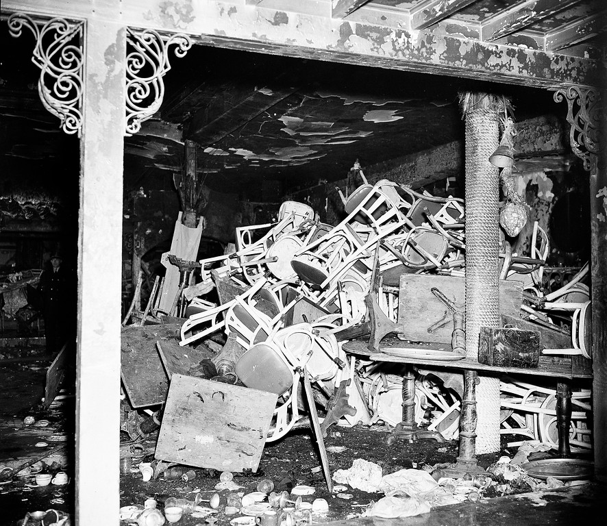 . Chairs are piled up inside the charred Cocoanut Grove night club in the Back Bay section of Boston, Nov. 29, 1942, after last night\'s fire in which 492 patrons of the club were killed.  (AP Photo)
