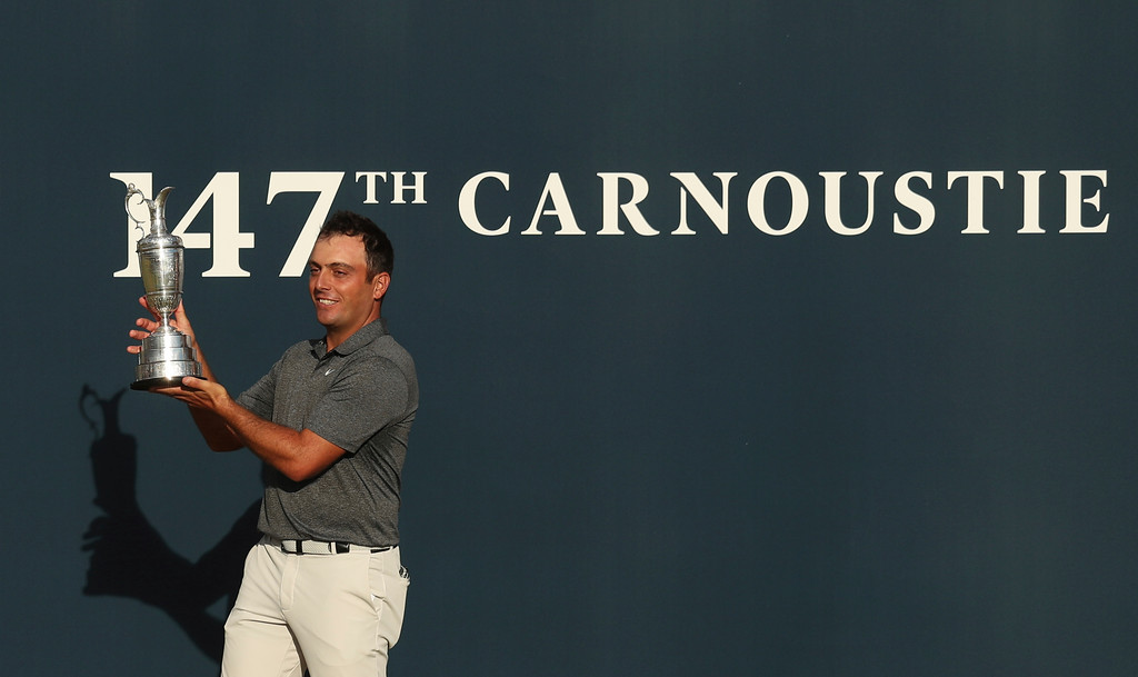 . Francesco Molinari of Italy holds the trophy after winning the British Open Golf Championship in Carnoustie, Scotland, Sunday July 22, 2018. (AP Photo/Jon Super)