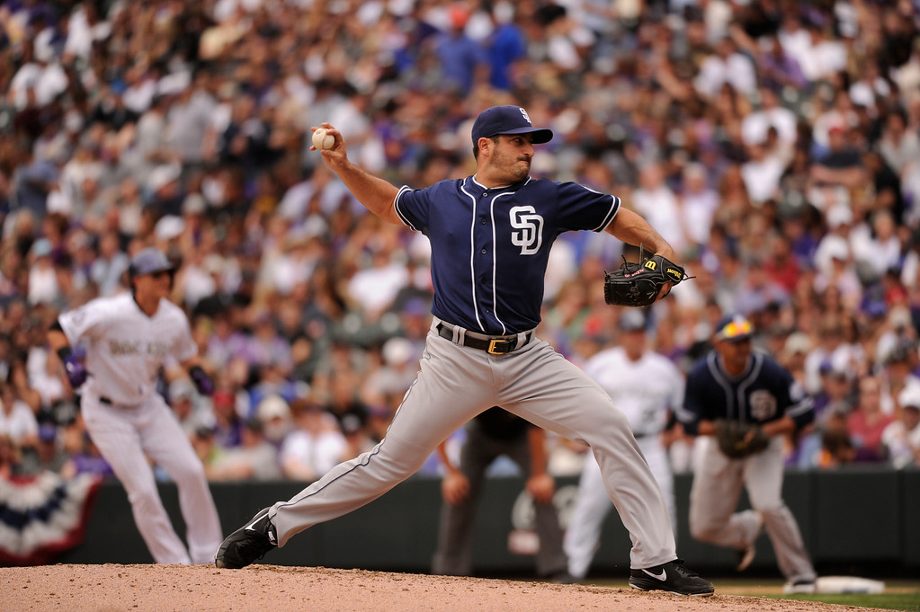 . Jason Marquis (21) of the San Diego Padres delivers a pitch in the fifth inning. (Photo by Karl Gehring/The Denver Post)