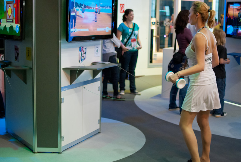 Girl playing Wii game at GamesCom 2011