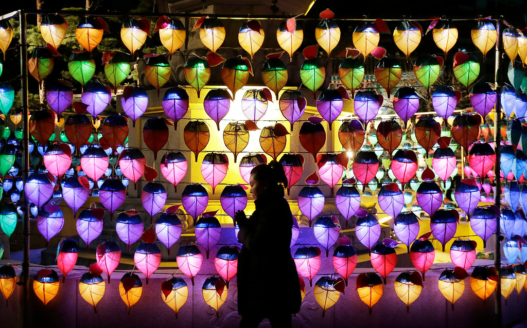 . A woman prays during New Year celebrations at Jogye Buddhist temple in Seoul, South Korea, Thursday, Jan. 1, 2015. (AP Photo/Ahn Young-joon)