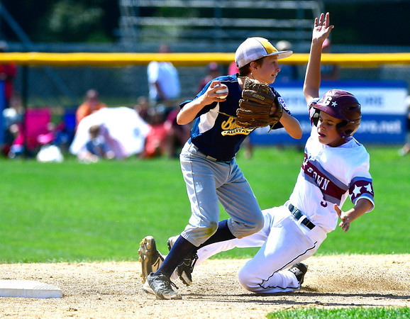 8/10/2019 Mike Orazzi | Staff Rhode Islands Barrington Little League's Cullen Crain (2)forces out New Hampshires Goffstown Junior Baseball Little League's Brock Bennett (5) at Breen Field in Bristol, Conn., during the New England Regional Baseball Tournament.