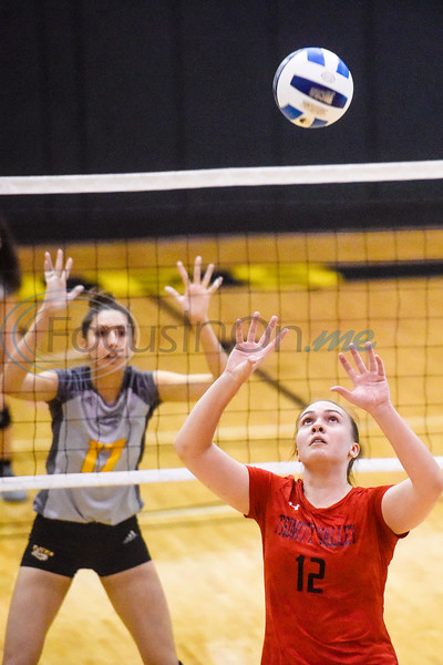Tyler Junior College's Vanessa Silva (17) waits at the net as Trinity Valley Community College's Ana Paula Zandona (12) sets the ball during a college volleyball game at Tyler Junior College in Tyler, Texas, on Wednesday, Sept. 19, 2018. (Chelsea Purgahn/Tyler Morning Telegraph)