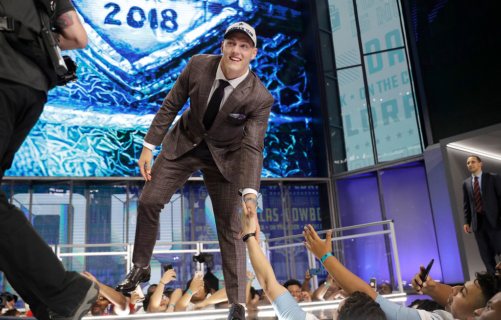 . Boise State\'s Leighton Vander Esch walks onto the stage after being selected by the Dallas Cowboys during the first round of the NFL football draft, Thursday, April 26, 2018, in Arlington, Texas. (AP Photo/David J. Phillip)