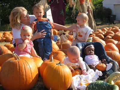 UCC Staff Kids in the Pumpkin Patch