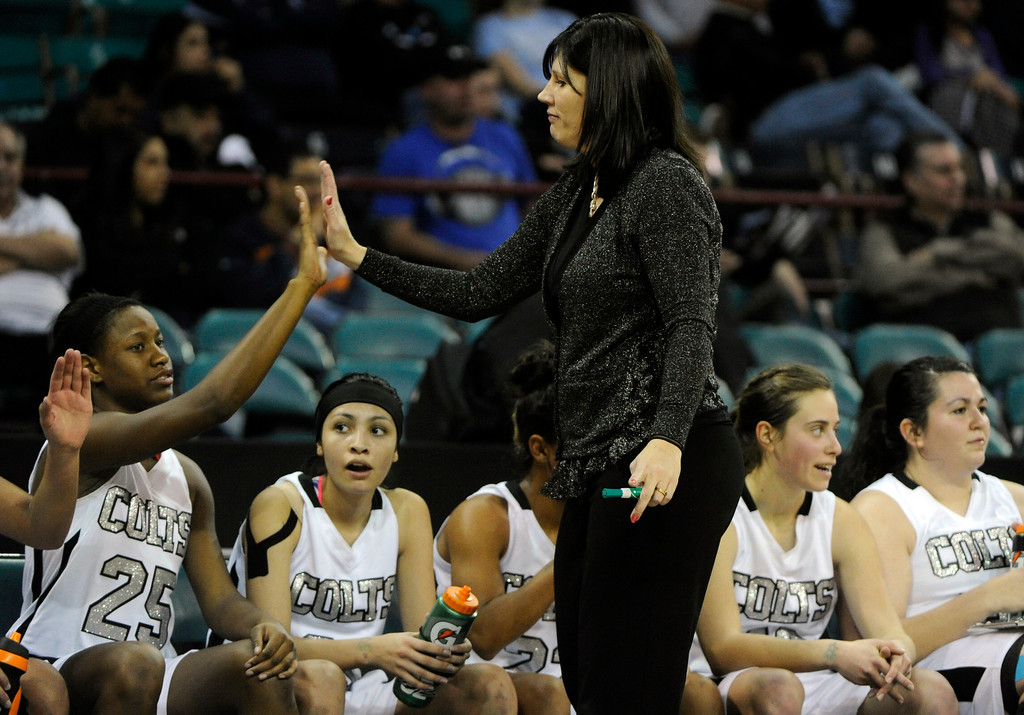 . DENVER, CO. - MARCH 9TH: Pueblo South head coach, Shannan Lane, congratulates player, Sissy Hall, and the rest of the starters who were pulled late in the second half  against Mesa Ridge High School in the second half of the 4A �Great Eight� game at the Denver Coliseum, Saturday morning, March 9th, 2013. Pueblo South won 54-33 to advance to the Final Four at the CU Events Center, March 14th, 2013. (Photo By Andy Cross The Denver Post)