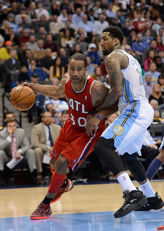 . Dahntay Jones (30) of the Atlanta Hawks drives on Wilson Chandler (21) of the Denver Nuggets during the third quarter March 4,  2013 at Pepsi Center. The Denver Nuggets defeated the Atlanta Hawks 104-88. (Photo By John Leyba/The Denver Post)