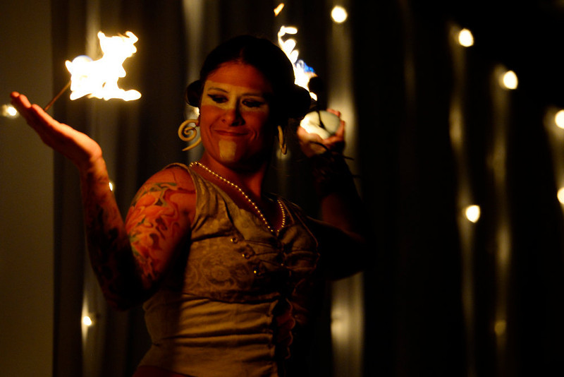 . DENVER, CO. - FEBRUARY 7: A fire dancer works the runway during the Whiteout 2013 at the McNichols Building. The winter-themed show and art exhibit celebrates local artists and designers. (Photo By AAron Ontiveroz/The Denver Post)