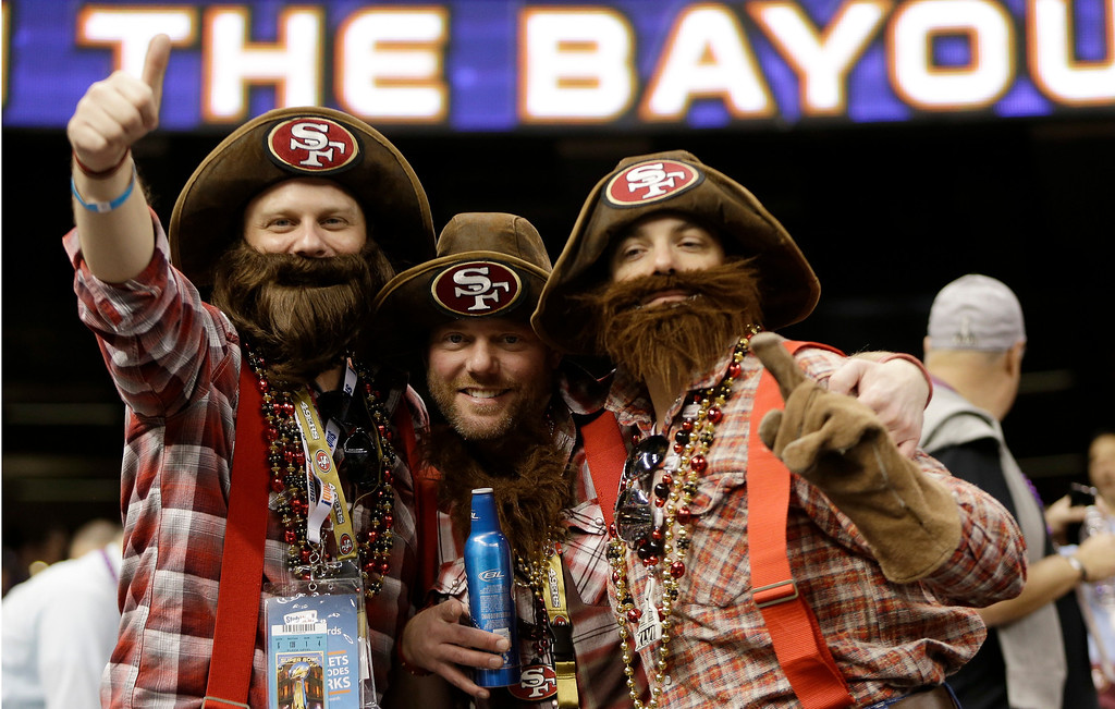 . From left, San Francisco 49ers fans Vince Knoss, Ryan Knoss and Gibran Farrah, all of San Francisco, cheer before the NFL Super Bowl XLVII football game between the 49ers and the Baltimore Ravens, Sunday, Feb. 3, 2013, in New Orleans. (AP Photo/Mark Humphrey)