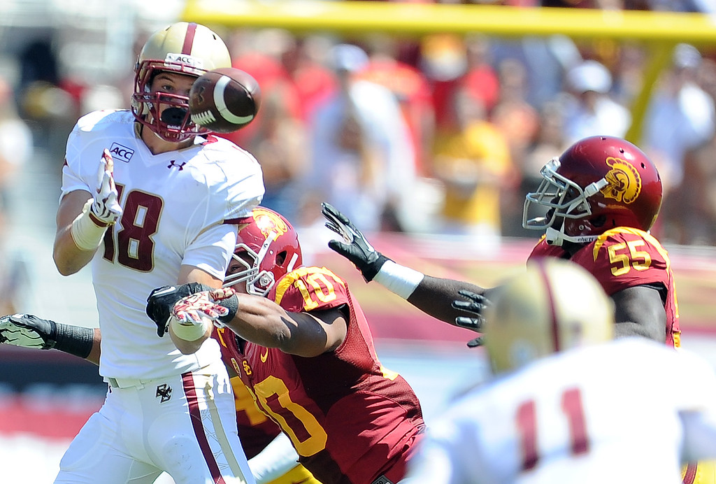 . Boston College\'s Dan Crimmins (18) can\'t handle a pass against Southern California during the first half of an NCAA college football game in the Los Angeles Memorial Coliseum in Los Angeles, on Saturday, Sept. 14, 2013.