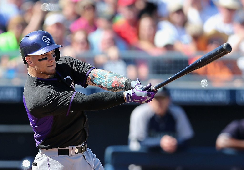 . Brandon Barnes #1 of the Colorado Rockies hits a RBI single against the Seattle Mariners during the third inning of the spring training game at Peoria Stadium on March 3, 2014 in Peoria, Arizona.  (Photo by Christian Petersen/Getty Images)
