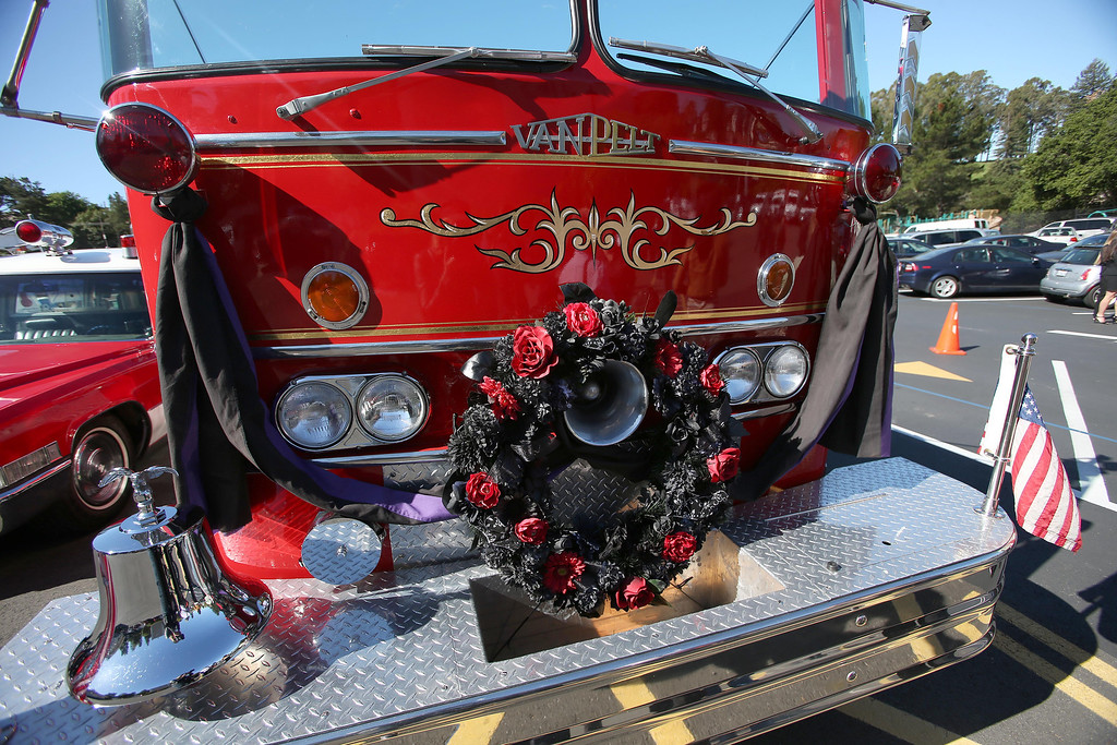. An ceremonial Oakland Fire Department truck is adorned with a black wreath and bunting during funeral services for Santa Clara paramedic Quinn Boyer, 34, of Dublin, at St. Theresa Catholic Church in Oakland, Calif., on Tuesday, April 16, 2013.  (Jane Tyska/Staff)