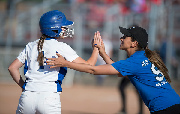 06/03/19 Wesley Bunnell | Staff Southington softball defeated Trumbull in a semifinal Class LL game at DeLuca Field in Stratford on Monday afternoon. Kelsey Fernandez (1) is congratulated by head coach Davina Hernandez at third base.