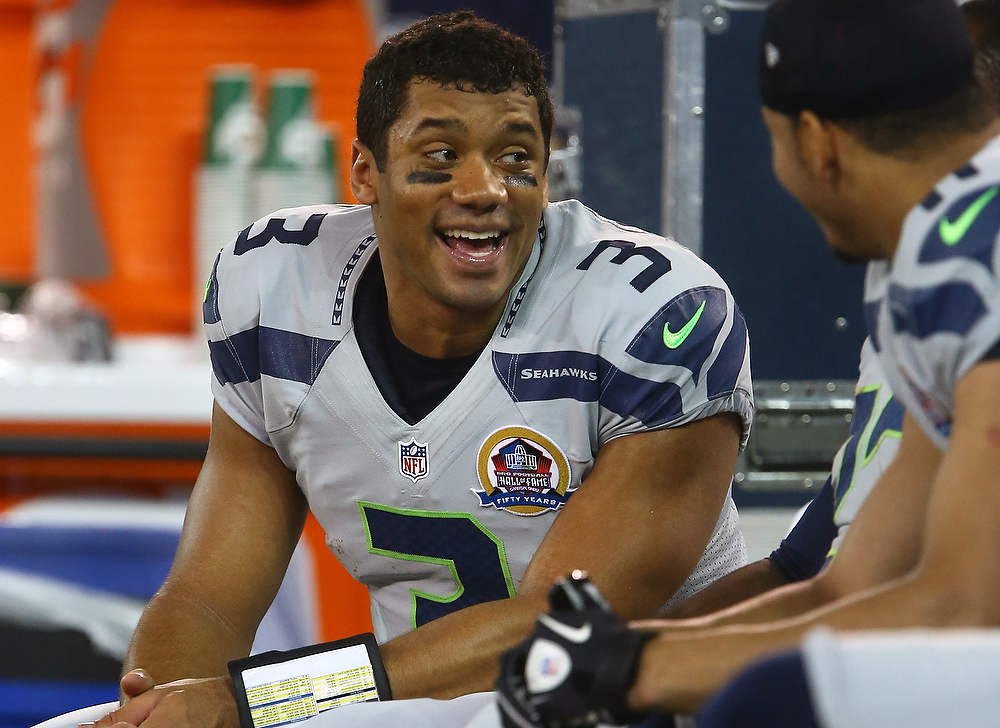 . Russell Wilson #3 of the Seattle Seahawks reacts late in the game after building up a comfortable lead during an NFL game against the Buffalo Bills at Rogers Centre on December 16, 2012 in Toronto, Ontario, Canada. (Photo by Tom Szczerbowski/Getty Images)