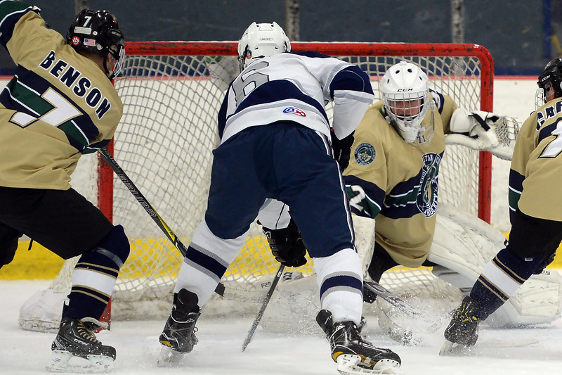 #6, Aidan Tolnai of the Manasquan High School Varsity Ice Hockey Team takes a shot on the Freehold net in their game played on 01/16/2019.(STEVE WEXLER/THE COAST STAR).