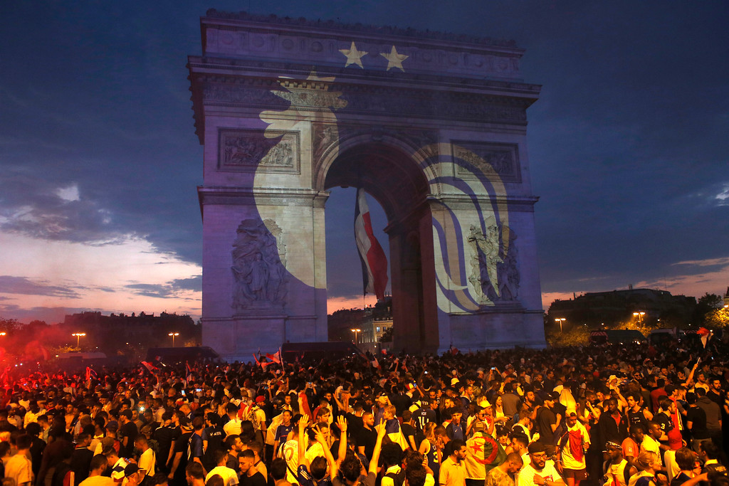 . A rooster, a symbol of France, and two stars indicating two World Cup wins, are projected onto the Arc de Triomphe after France won the soccer World Cup final match between France and Croatia, Sunday, July 15, 2018 in Paris. France won its second World Cup title by beating Croatia 4-2. (AP Photo/Thibault Camus)