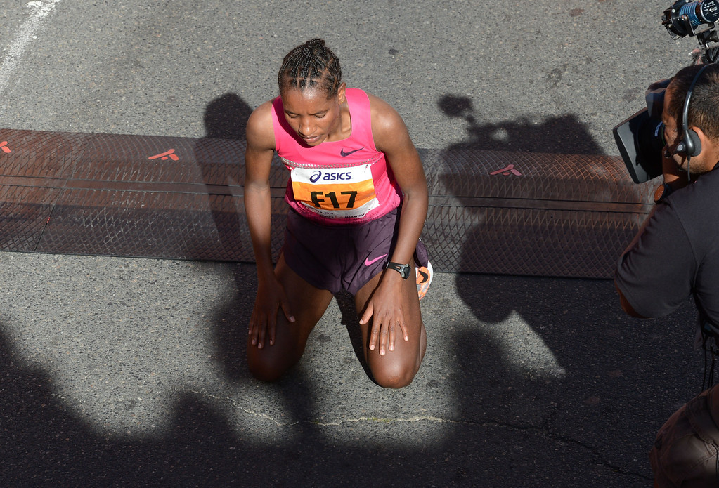 . 2014 ASICS LA Marathon women\'s winner Amane Gobena of Ethiopia, after she crossed the finish line in Santa Monica Calif, with a time of 2: 27:37.   Sunday, March 9,  2014.   (Photo by Stephen Carr / Daily Breeze)