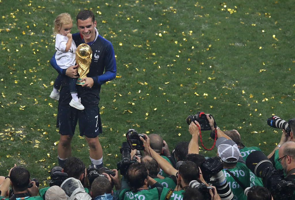. France\'s Antoine Griezmann poses with the trophy at the end of the final match between France and Croatia at the 2018 soccer World Cup in the Luzhniki Stadium in Moscow, Russia, Sunday, July 15, 2018. (AP Photo/Thanassis Stavrakis)