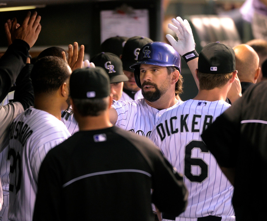 . DENVER, CO. - SEPTEMBER 4: Todd Helton received congrats in the dugout following his second inning home run. The Colorado Rockies hosted the Los Angeles Dodgers at Coors Field Wednesday night, September 4, 2013.  Photo By Karl Gehring/The Denver Post