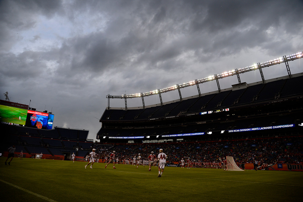 . DENVER, CO - MAY 16: Clouds roll in as the Denver Pioneers and the Ohio State Buckeyes play during the second half of Denver\'s 15-13 NCAA tournament quarterfinal win. The Denver Pioneers played the Ohio State Buckeyes at Sports Authority field at Mile High on Saturday, May 16, 2015. (Photo by AAron Ontiveroz/The Denver Post)